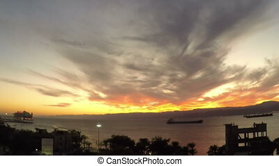 EVENING CLOUDS FAST MOVING AWAY, ROLLING DARK SUNSET CLOUDS, Red purple orange blue pink sunset sky cloud Red purple cloudscape time lapse background Over red sea in Aqaba Jordan