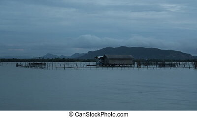 Evening cloudy time lapse of Ko Yo island fisherman village,...