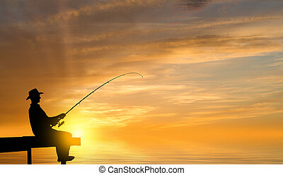 Evening fishing - Silhouette of man sitting at bridge and...