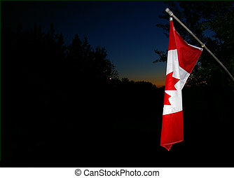 evening flag - A Canadian flag in the late evening, taken in...