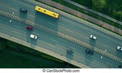 Evening highway traffic. 4K aerial video, top down view