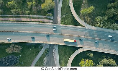 Evening highway traffic. Aerial shot, top down view