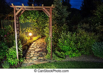 Evening in the Garden. Garden Illumination at Night.