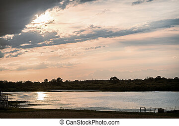 Evening landscape: sunset over a small river