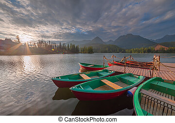 Evening landscape with boats on lake