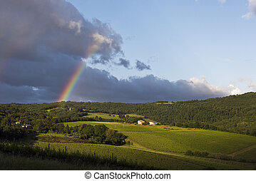 Evening landscape with rainbow. Tuscany, Italy