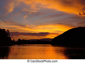 Evening landscape with sunset on the mountain river.