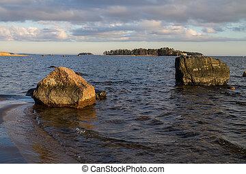 Evening light in the ocean shore rocks
