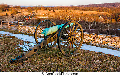Evening light on a cannon and battlefields in Antietam...