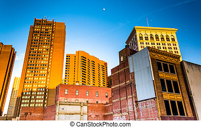 Evening light on a cluster of buildings in downtown Baltimore, Maryland.