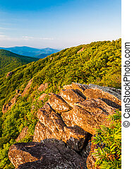 Evening light on a rock outcrop and the Blue Ridge Mountains from the Pinnacle, along the Appalachian Trail in Shenandoah National Park, Virginia.