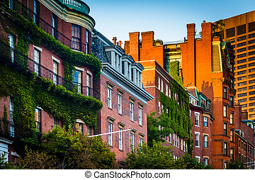 Evening light on brick buildings along Beacon Street in Boston, Massachusetts.