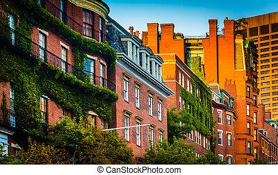 Evening light on brick buildings along Beacon Street in Boston,