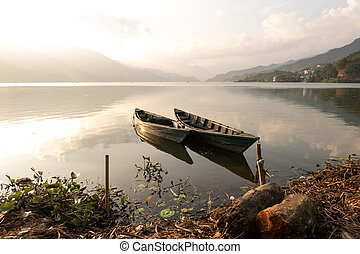 Evening Light on the Boats of Fewa Lake