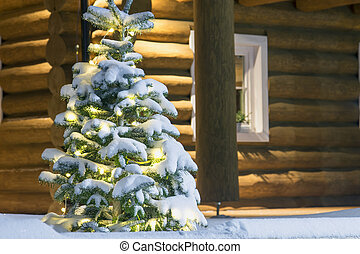 Evening lighted wooden house detail