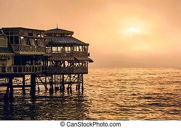 Evening Lima. Sunset on the Pacific Ocean, the sun breaks ...