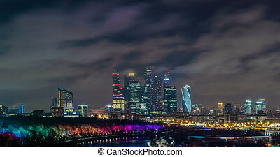 Evening Moscow, time lapse, fast flying clouds in the night sky over Moscow, 4k, beautiful evening cityscape, view from Vorobyovy Gory