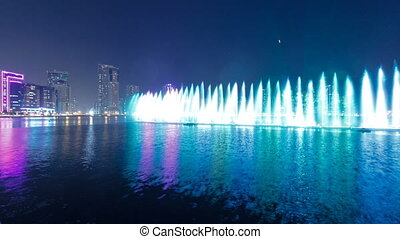 Evening Musical fountain show. Singing fountains in Sharjah timelapse, UAE