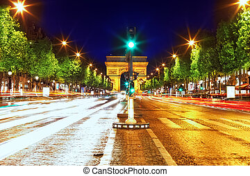 Evening on Champs-Elysees in front of Arc de Triomphe. Paris. France