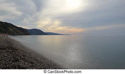 Evening on sea beach timelapse