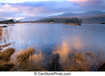 evening on Upper Lake, Killarney, Co.Kerry, showing mist shrouded mountains in background
