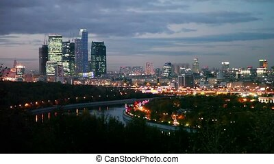 evening panorama of Moscow City skyscrapers complex and Moskva river