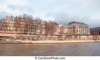 evening Paris from moving cutter on Siene river in sunset...
