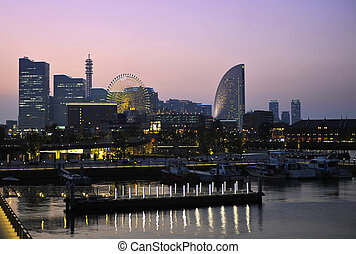 Yokohama - Evening photo of Yokohama downtown reflcting in...