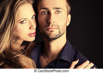 evening - Portrait of a beautiful young couple in love ...