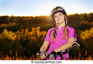 evening portrait of a cycling woman