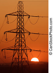 evening pylon - Electricity transmission pylon against a ...