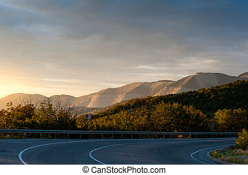 Evening road and range of mountains
