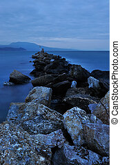 Evening rocky seascape