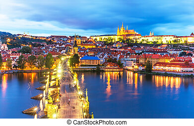 Scenic summer evening panorama of the Old Town architecture with Vltava river, Charles Bridge and St.Vitus Cathedral in Prague, Czech Republic