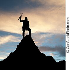 man on mountains with ice axe in hand