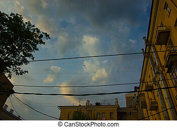 Evening sky over the rooftops of residential area
