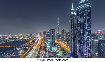 Evening skyline with modern skyscrapers and traffic on...