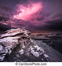 Evening Storm - Rugged natural landscape with an evening...