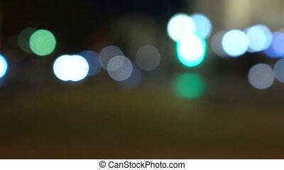 Evening street. Lights and cars. 4K background bokeh shot -...