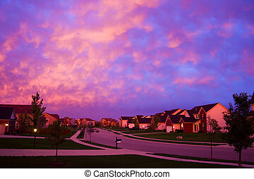Evening suburbia - A street in a suburbian neighborhood with...