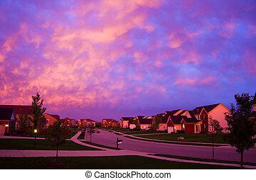 Evening suburbia - A street in a suburbian neighborhood with...