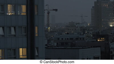 Evening Tel Aviv view with houses and cranes, Israel -...