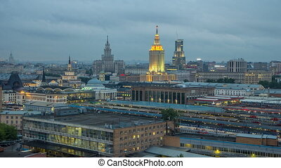 Evening top view of three railway stations day to night timelapse at the Komsomolskaya square in Moscow, Russia