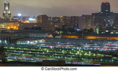 Evening top view of three railway stations night timelapse at the Komsomolskaya square in Moscow, Russia