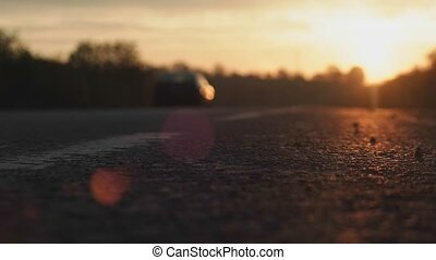 Evening video of a road with a car going somewhere during a perfect sunset