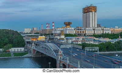 Evening view at the Russian Academy of Sciences day to night timelapse and Novoandreevsky Bridge over the Moscow River.