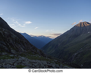 Evening view from Nurnberger Hutte mountain hut at valley with sharp mountain peaks at Stubai hiking trail, Stubai Hohenweg, Summer rocky alpine landscape of Tyrol, Stubai Alps, Austria