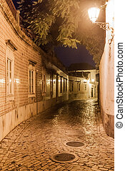 Evening view of a street in the Old Town Cidade Velha of Faro, Portuga