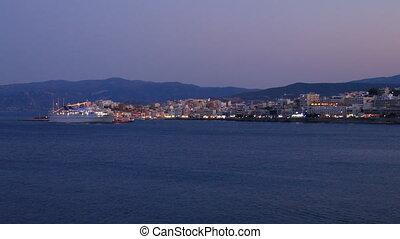 Evening view of Agios Nikolaos city across the bay, Crete