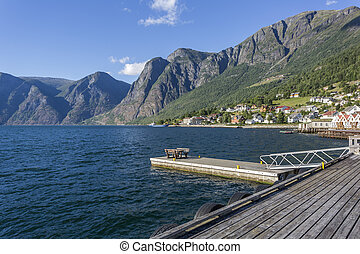 Evening view of Aurlandsvangen waterfront with beautiful mountain range in the background